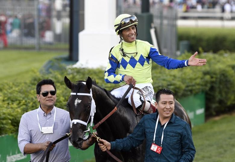 May 6, 2017; Louisville , KY, USA; John Velazquez aboard Always Dreaming (5) celebrates after winning the 2017 Kentucky Derby at Churchill Downs. Mandatory Credit: Jamie Rhodes-USA TODAY Sports