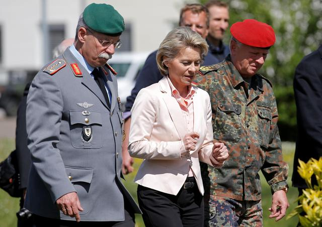 FILE PHOTO: German Defence Minister Ursula von der Leyen (C) walks with General Joerg Vollmer, General Inspector of the German Land Army (L), and General Volker Wieker, Inspector General of Germany's Armed Forces in Bundeswehr, during her visit at the 291st fighter squadron based at the ''Quartier Leclerc'', a military facility for French and German military units in Illkirch-Graffenstaden near Strasbourg, France May 3, 2017. REUTERS/Vincent Kessler