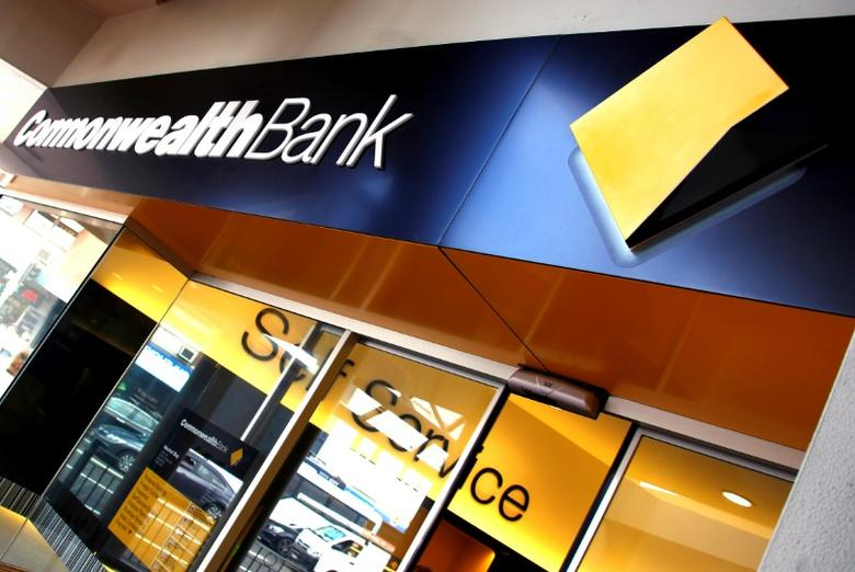 FILE PHOTO -  The logo of the Commonwealth Bank of Australia (CBA) is displayed outside a branch in Sydney, Australia, March 21, 2016.  REUTERS/David Gray/File Photo