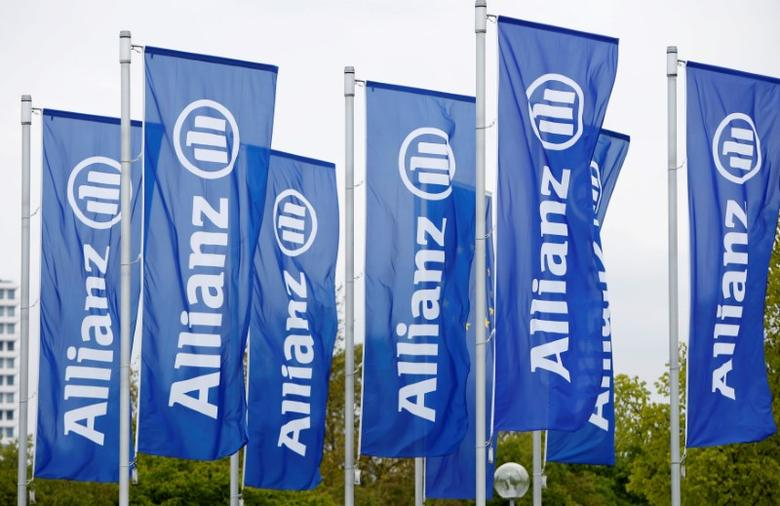 FILE PHOTO: Flags with the logo of Allianz SE, Europe's biggest insurer, are pictured before the company's annual shareholders' meeting in Munich, Germany May 3, 2017. REUTERS/Michaela Rehle/File Photo