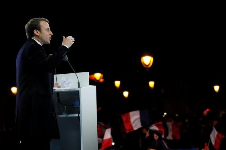 French President elect Emmanuel Macron delivers a speech during his victory rally near the Louvre museum after results in the 2017 presidential election in Paris, France, May 7, 2017.  REUTERS/Thomas Samson/Pool