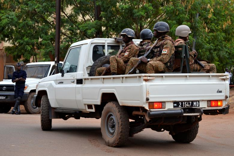 Soldiers patrol during the trial of officials and ministers of the former leader of Burkina Faso, Blaise Compaore at the justice palace, in Ouagadougou, Burkina Faso May 4, 2017. REUTERS/Bonaventure Pare