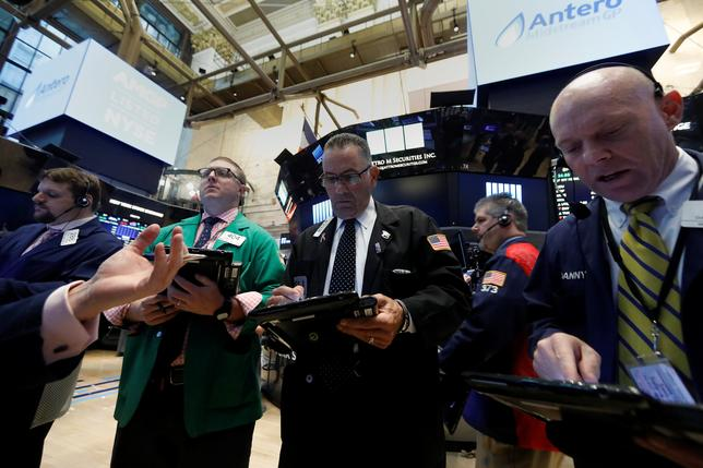 FILE PHOTO: Traders work on the floor of the New York Stock Exchange in the Manhattan borough of New York, U.S. May 4, 2017. REUTERS/Brendan McDermid