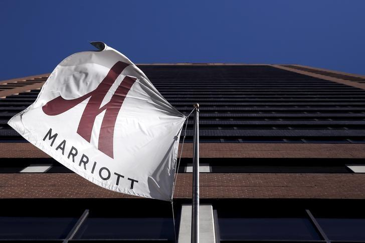A Marriott flag hangs at the entrance of the New York Marriott Downtown hotel in Manhattan, New York November 16, 2015. REUTERS/Andrew Kelly