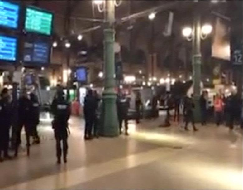 Police officers are seen at the Paris' Gare du Nord train station, France in this still image taken from video posted to social media May 8, 2017. Le Dernier Bantou/Social Media/Handout via REUTERS