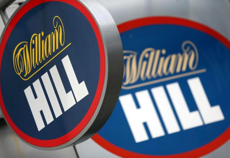 FILE PHOTO:  A branded sign is displayed outside a William Hill betting shop in London, Britain, July 25, 2016.   REUTERS/Neil Hall/File Photo
