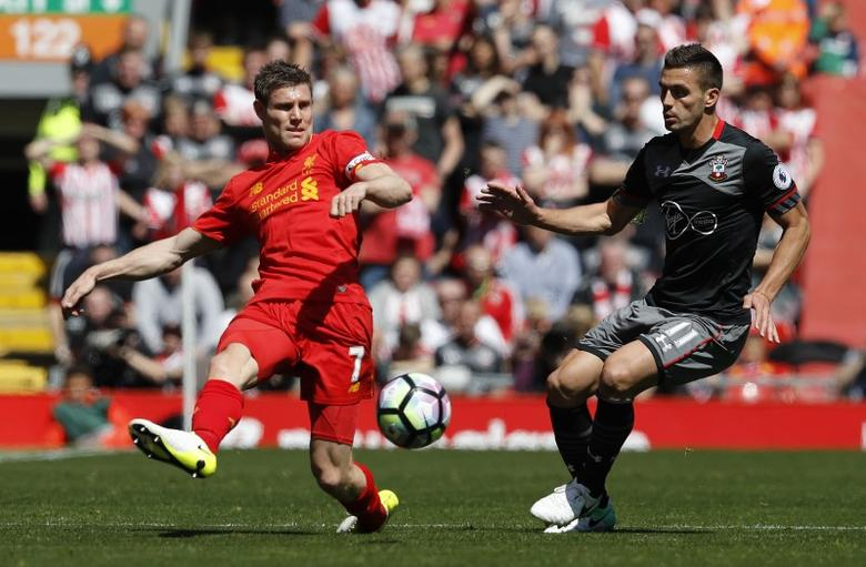 Britain Soccer Football - Liverpool v Southampton - Premier League - Anfield - 7/5/17 Southampton's Dusan Tadic in action with Liverpool's James Milner  Reuters / Phil Noble Livepic