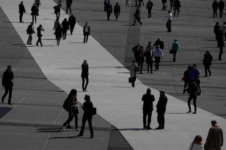 People walk on the esplanade of La Defense at the financial and business district of La Defense, west of Paris, France, March 27, 2017. Picture taken March 27, 2017. REUTERS/Vincent Kessler