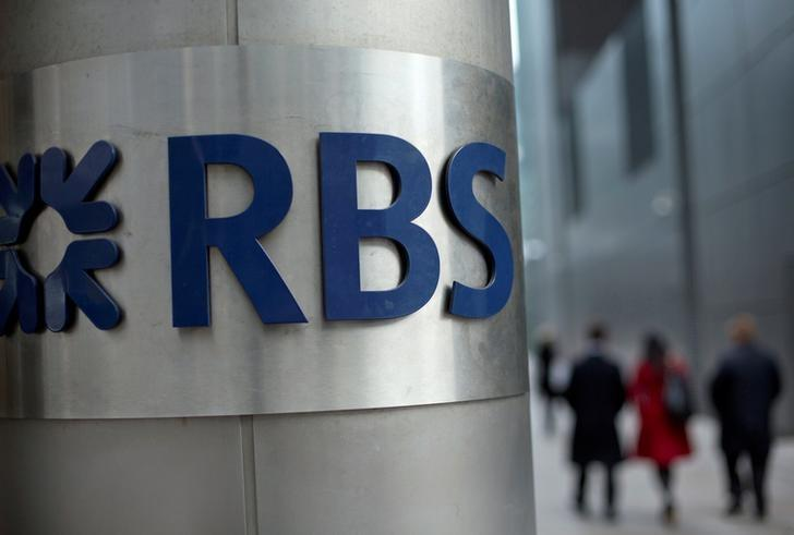 FILE PHOTO: People walk past a Royal Bank of Scotland office in London, Britain, February 6, 2013.    REUTERS/Neil Hall/File Photo
