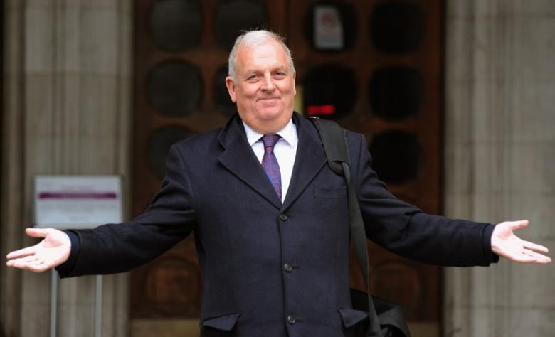 Former Sun newspaper editor Kelvin MacKenzie gestures as he leaves the Leveson Inquiry at the High Court in central London, January 9, 2012.    REUTERS/Paul Hackett  (BRITAIN - Tags: POLITICS MEDIA) - RTR2W1YE