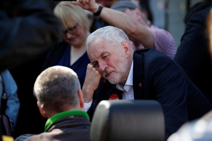 Jeremy Corbyn, the leader of Britain's opposition Labour Party, speaks to a man in a mobility scooter as he campaigns in Whythenshawe, May 9, 2017. REUTERS/Andrew Yates
