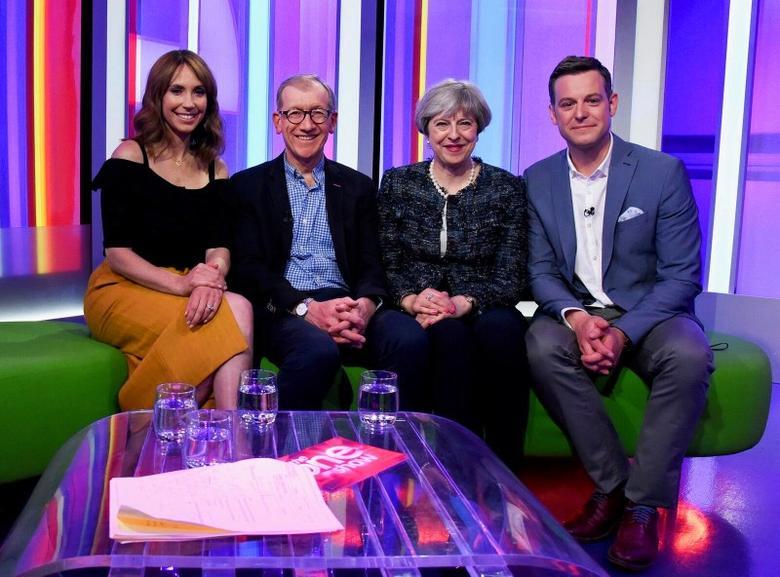 Britain's Prime Minister Theresa May and her husband Philip sit with BBC Television's One Show presenters Matt Baker and Alex Jones at the BBC in London, Britain May 9, 2017. Picture issued by the Conservative Party/Handout via REUTERS.