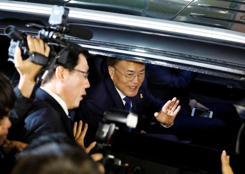 South Korea's president-elect Moon Jae-in leaves his house to meet supporters at Gwanghwamun Square in Seoul, South Korea May 9, 2017. REUTERS/Kim Hong-Ji