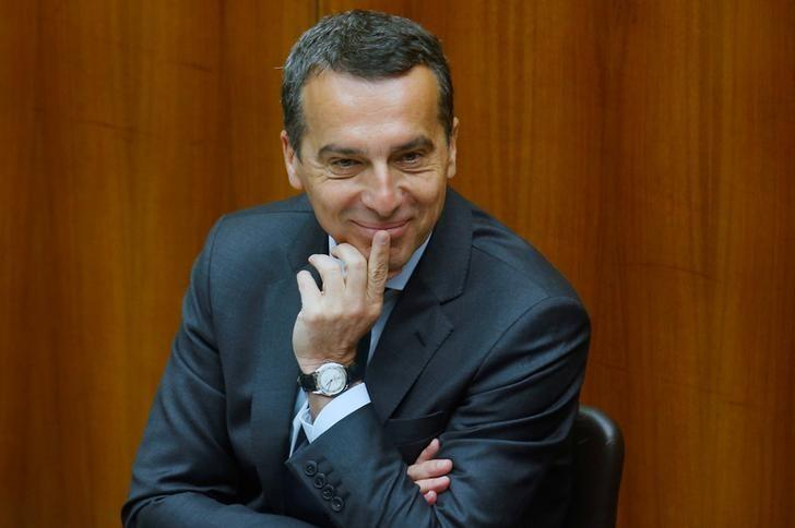 Austria's Chancellor Christian Kern smiles as he waits to deliver a speech during a session of the parliament in Vienna, Austria April 26, 2017. REUTERS/Heinz-Peter Bader