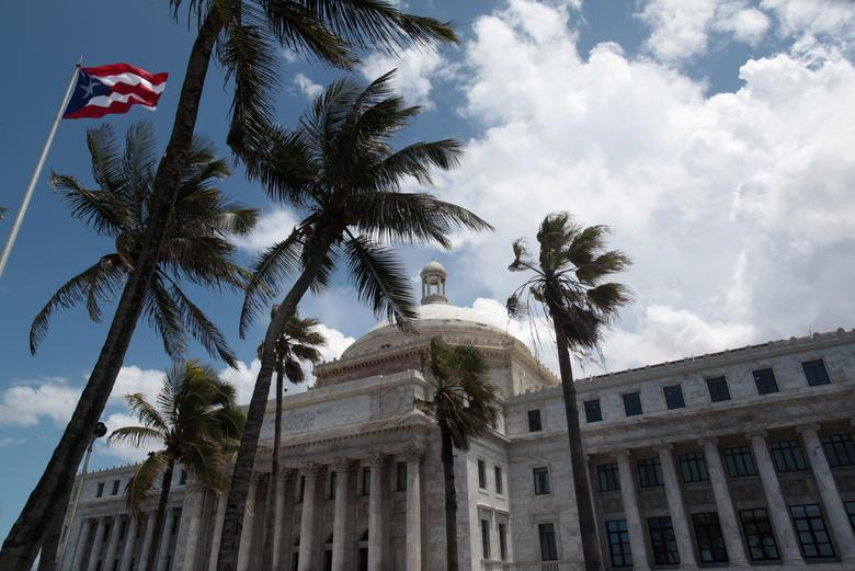 FILE PHOTO: The flag of Puerto Rico flies outside the Capitol building in San Juan, Puerto Rico May 4, 2017. REUTERS/ Alvin Baez