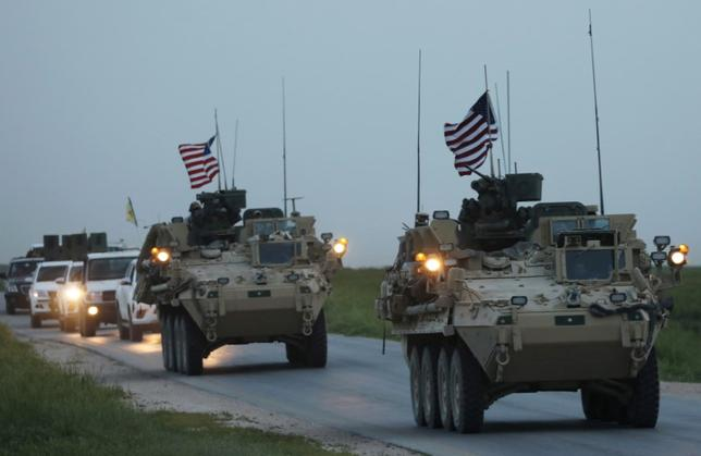 FILE PHOTO: U.S military vehicles and Kurdish fighters from the People's Protection Units (YPG) drive in the town of Darbasiya next to the Turkish border, Syria April 28, 2017. REUTERS/Rodi Said