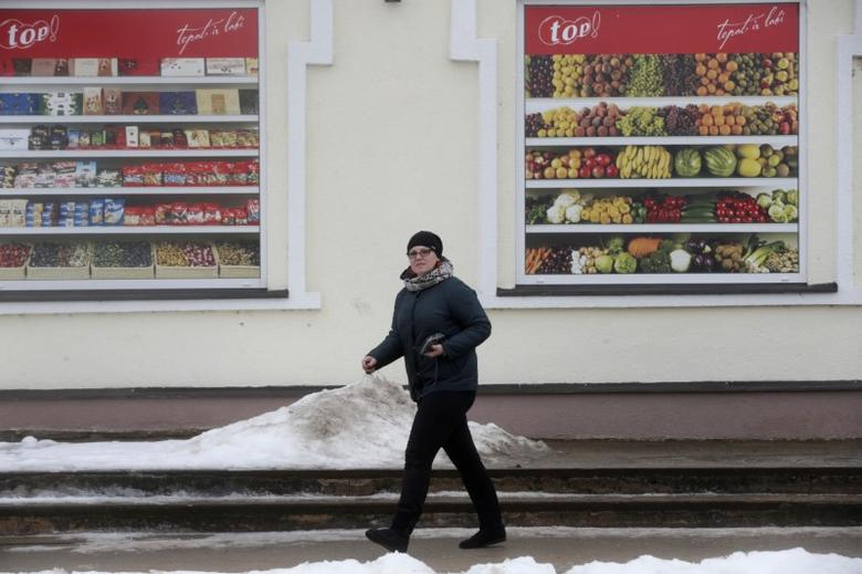 A woman leaves a local shop about 5 km (3,1 miles) from the border with Russia in Karsava, Latvia, January 28, 2017.  REUTERS/Ints Kalnins