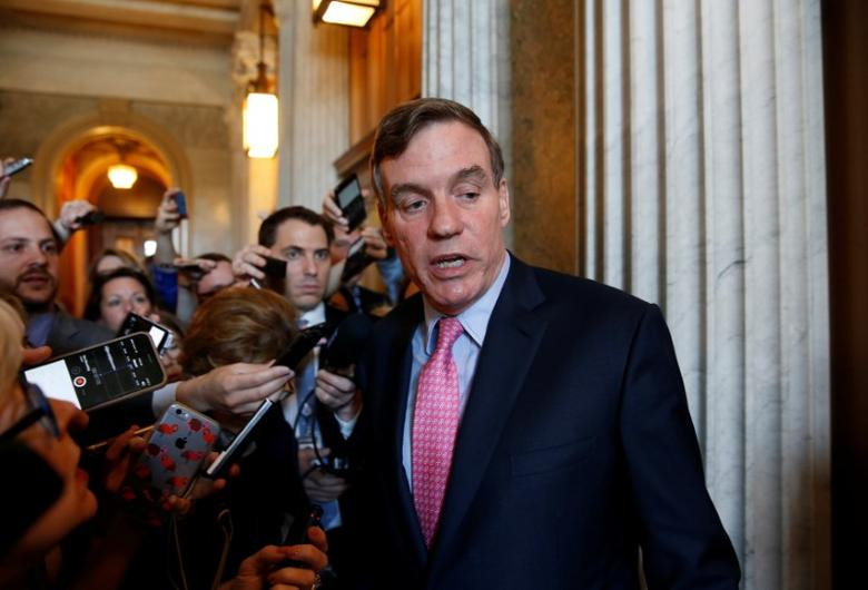 Senator Mark Warner (D-VA) speaks to reporters after a Democratic caucus meeting at the U.S. Capitol in Washington, U.S., May 10, 2017.      REUTERS/Joshua Roberts
