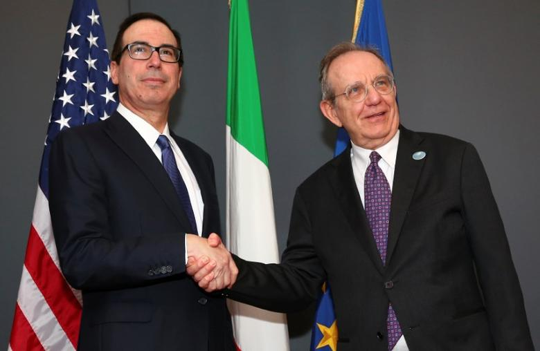 U.S. Secretary of the Treasury Steven Mnuchin (L) and Italy's Finance Minister Pier Carlo Padoan shake hands before a bilateral meeting, during a G7 for Financial ministers, in the southern Italian city of Bari, Italy May 11, 2017. REUTERS/Alessandro Bianchi