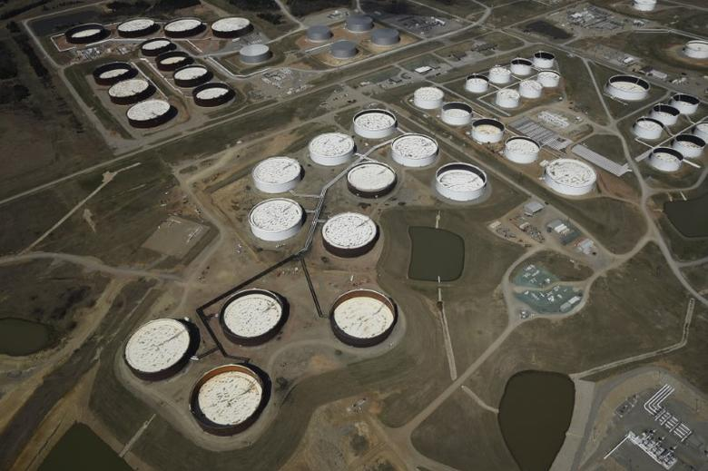 FILE PHOTO: Crude oil storage tanks are seen from above at the Cushing oil hub, in Cushing, Oklahoma, in this March 24, 2016 file photo.  REUTERS/Nick Oxford