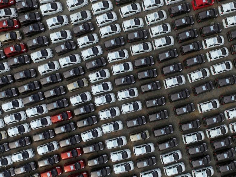 FILE PHOTO: Electric cars are seen at a parking lot of an automobile factory in Xingtai, Hebei province, China April 26, 2016. REUTERS/Stringer/File Photo REUTERS