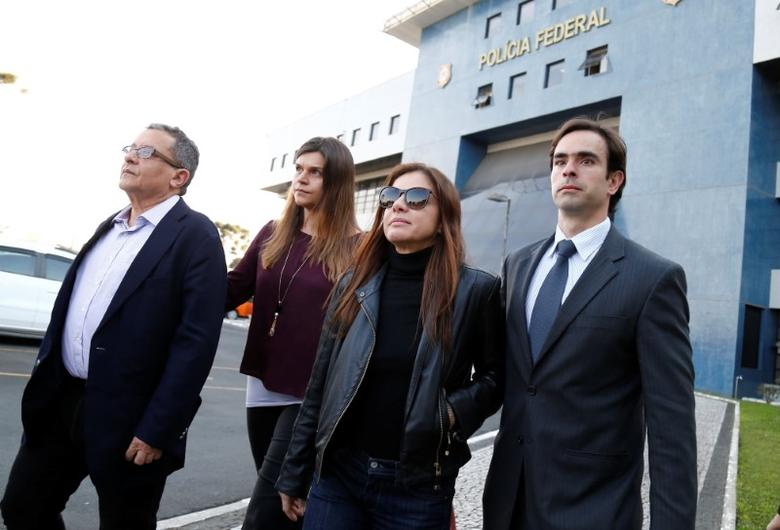 FILE PHOTO: Joao Santana (L), former Brazilian President Dilma Rousseff's campaign chief and his wife Monica Moura (2nd R), leave a federal prison after being released on bail in Curitiba, August 1, 2016. REUTERS/Rodolfo Buhrer