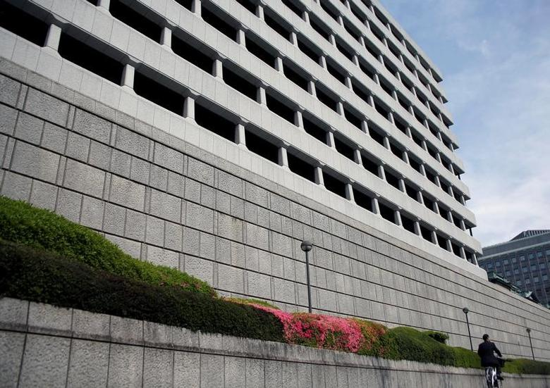 A man riding a bicycle rides past the Bank of Japan building in Tokyo, Japan April 27, 2017. REUTERS/Kim Kyung-Hoon