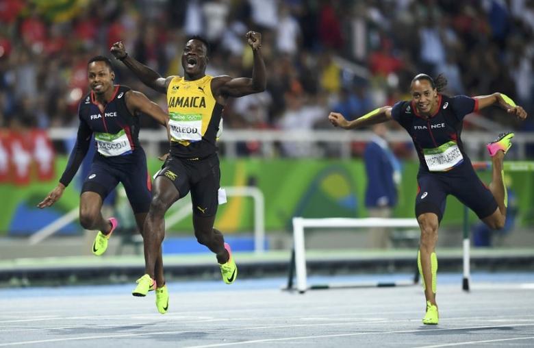 FILE PHOTO: 2016 Rio Olympics - Athletics - Final - Men's 110m Hurdles Final - Olympic Stadium - Rio de Janeiro, Brazil - 16/08/2016. Omar McLeod (JAM) of Jamaica celebrates as he wins the race   REUTERS/Dylan Martinez