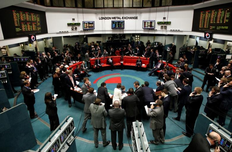 Traders and clerks react on the floor of the London Metal Exchange in the City of London February 14, 2012. REUTERS/Luke MacGregor/File Photo