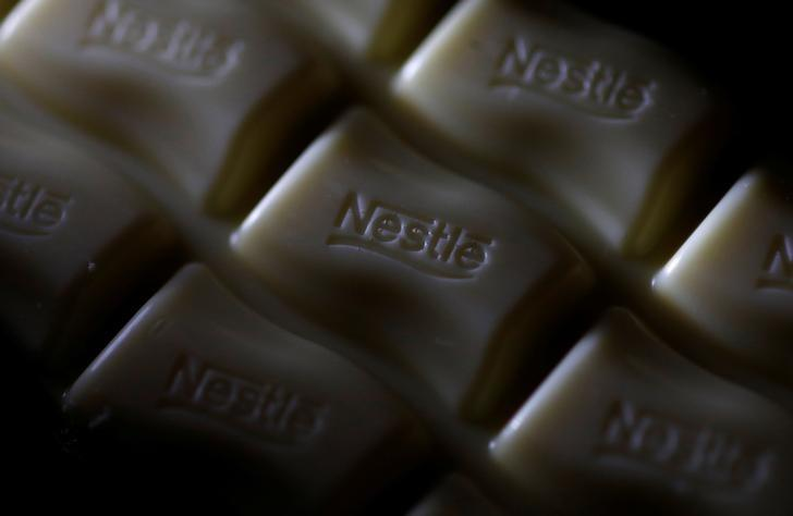 A Nestle company logo is pictured on a bar of Milky Bar chocolate in Manchester, Britain April 25, 2017. REUTERS/Phil Noble/Files