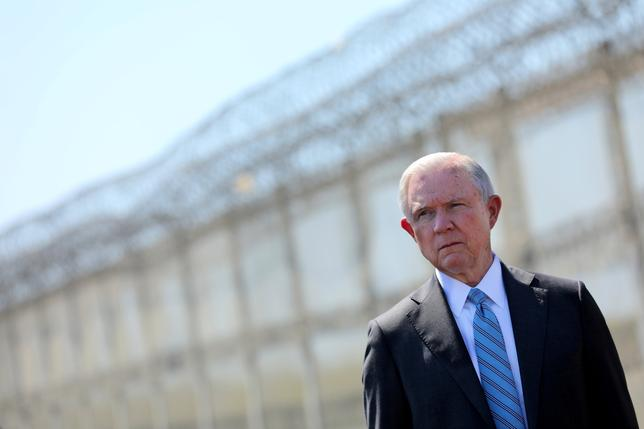 FILE PHOTO: Attorney General Jeff Sessions looks out towards Mexico as he stands by a secondary border fencer during visit to the U.S. Mexico border fence in San Diego, California, U.S. on April 21, 2017.  REUTERS/Mike Blake/File Photo