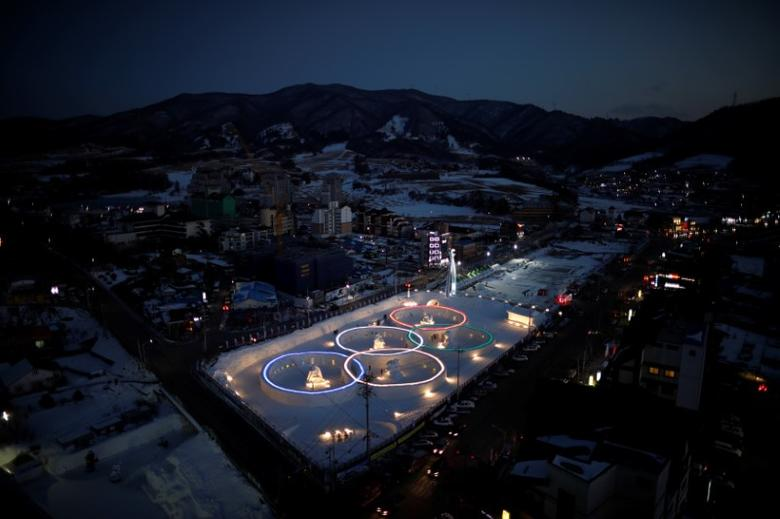 An ice sculpture of the Olympic rings is illuminated during the Pyeongchang Winter Festival, near the venue for the opening and closing ceremony of the PyeongChang 2018 Winter Olympic Games in Pyeongchang, South Korea, February 10, 2017.  REUTERS/Kim Hong-Ji