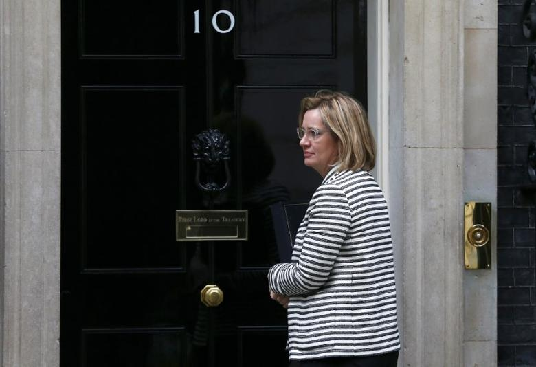 Britain's Home Secretary Amber Rudd waits for the door of 10 Downing Street to be opened for her, in London, May 3, 2017. REUTERS/Neil Hall