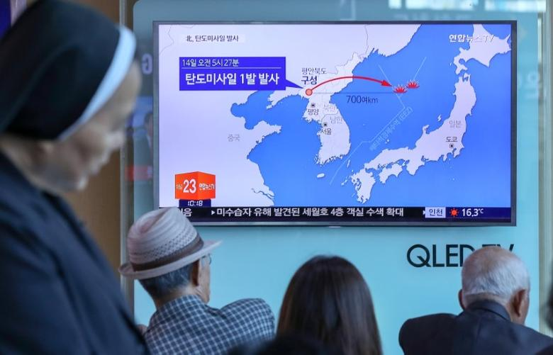 People watch a news report on North Korea firing a ballistic missile, at a railway station in Seoul, South Korea, May 14, 2017.   Kim Do-hoon/Yonhap via REUTERS