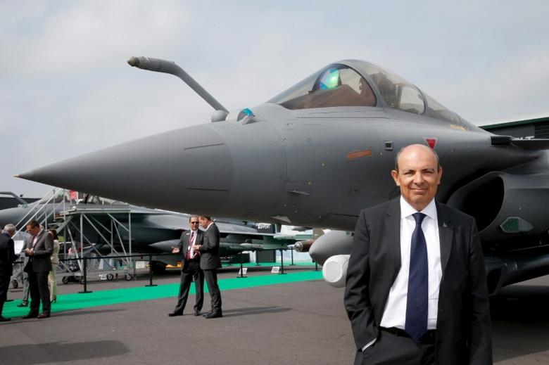 Eric Trappier, Dassault Aviation CEO, poses for pictures in front of an Dassault Rafale C fighter during the 51st Paris Air Show at Le Bourget airport near Paris, June 15, 2015. REUTERS/Pascal Rossignol