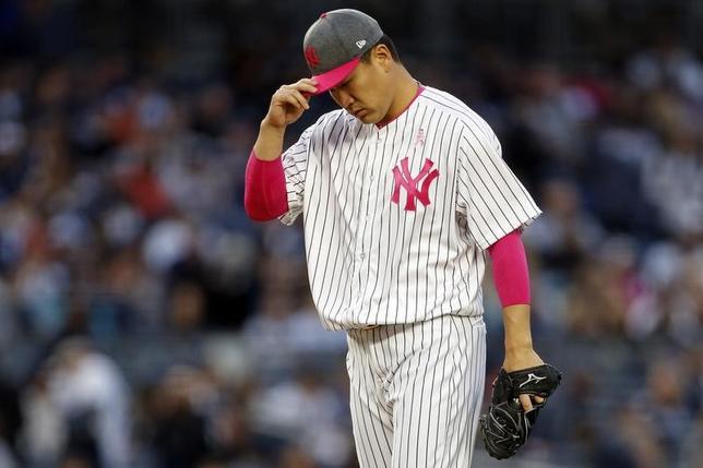5月14日、MLBヤンキースの田中将大投手は、地元でのアストロズ戦に先発登板し、2回途中8失点の乱調で今季2敗目(5勝)を喫した(2017年 ロイター/Adam Hunger-USA TODAY Sports)