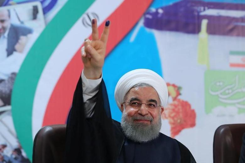 FILE PHOTO: Iran's President Hassan Rouhani gestures as he registers to run for a second four-year term in the May election, in Tehran, Iran, April 14, 2017. President.ir/Handout/File Photo via REUTERS