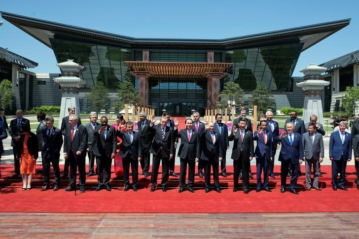 Leaders attending the Belt and Road Forum wave as they pose for a group photo at the Yanqi Lake venue on the outskirt of Beijing, China, May 15, 2017. REUTERS/Ng Han Guan/Pool