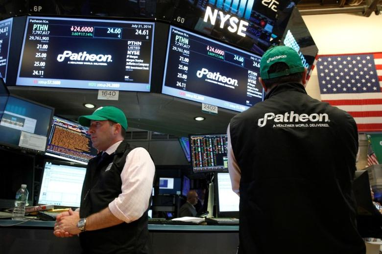 Traders work at the post where shares of Patheon NV is traded on the floor of the New York Stock Exchange (NYSE) in New York City, U.S., July 21, 2016.  REUTERS/Brendan McDermid  - RTSJ1ZS