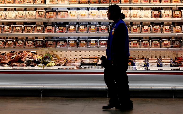 FILE PHOTO - A employee walks by a meat cooler in the grocery section of a Sam's Club during a media tour in Bentonville, Arkansas, U.S. on June 5, 2014.   REUTERS/Rick Wilking/File Photo