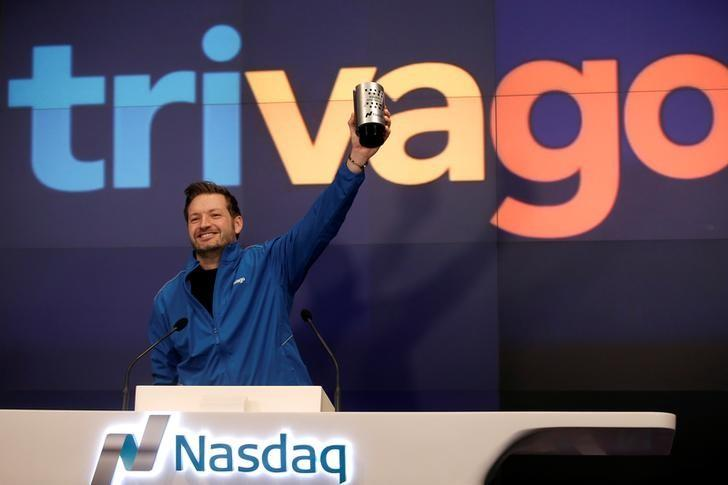 FILE PHOTO - Trivago co-founder and CEO Rolf Schromgens celebrates before ringing the opening bell on the Nasdaq  Stock Market as Trivago (TRVG), the hotel search platform, was listed during an initial public offering (IPO) at the Nasdaq Market Site in New York, U.S., December 16, 2016. REUTERS/Mike Segar