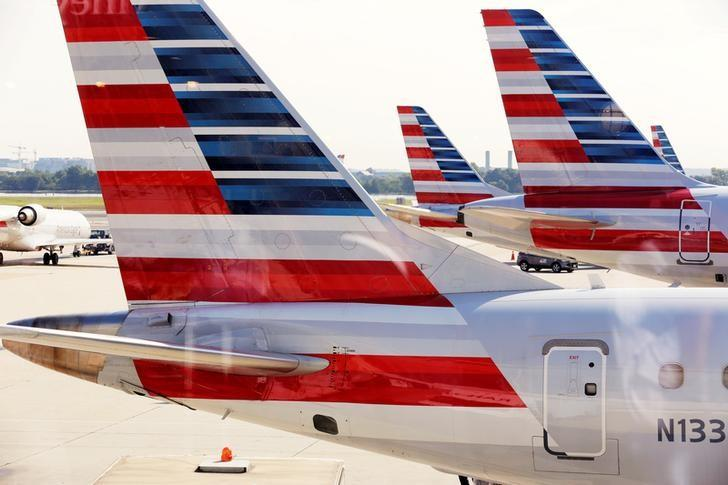 American Airlines aircraft are parked at Ronald Reagan Washington National Airport in Washington, U.S., August 8, 2016. REUTERS/Joshua Roberts/File Photo