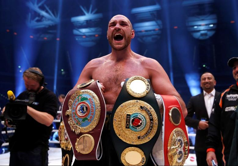 FILE PHOTO - Boxing - Wladimir Klitschko v Tyson Fury WBA, IBF & WBO Heavyweight Title's - Esprit Arena, Dusseldorf, Germany - 28/11/15Tyson Fury celebrates winning the fightAction Images via Reuters / Lee SmithLivepic/File Photo