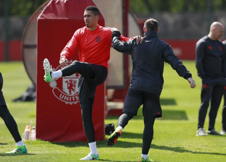 Britain Soccer Football - Manchester United Training - Manchester United Training Ground - 3/5/17 Manchester United's Chris Smalling and Wayne Rooney during training Action Images via Reuters / Jason Cairnduff Livepic