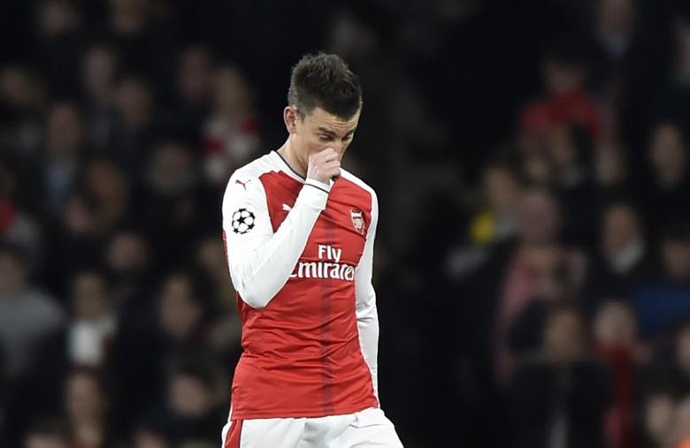 Britain Football Soccer - Arsenal v Bayern Munich - UEFA Champions League Round of 16 Second Leg - Emirates Stadium, London, England - 7/3/17 Arsenal's Laurent Koscielny walks off dejected after being sent off Reuters / Hannah McKay Livepic