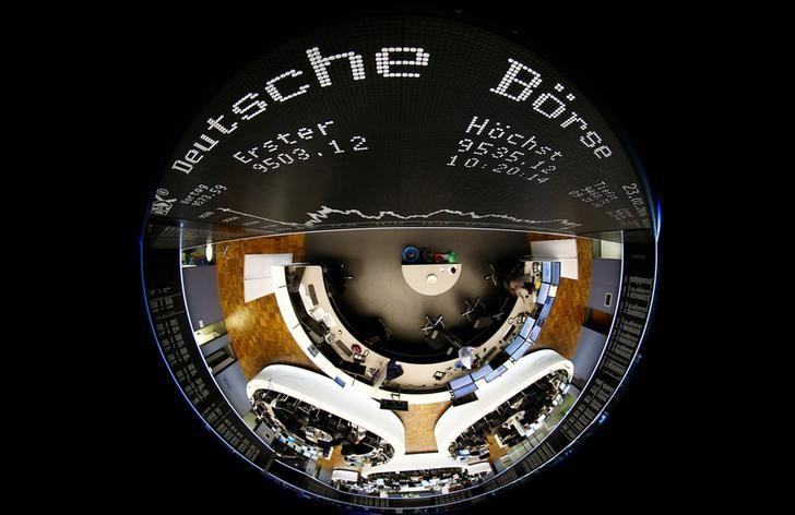 FILE PHOTO: The German share prize index (DAX) board and the trading room of Frankfurt's stock exchange (Boerse Frankfurt) are photographed with a circular fisheye lens during afternoon trading session in Frankfurt, Germany, February 23, 2016. REUTERS/Kai Pfaffenbach/File Photo