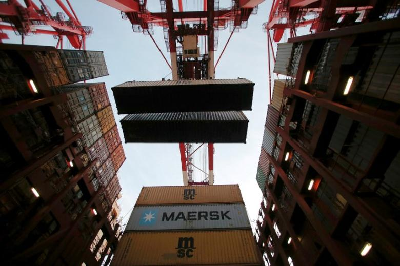 FILE PHOTO: Containers are seen unloaded from the Maersk's Triple-E giant container ship Maersk Majestic, one of the world's largest container ships, at the Yangshan Deep Water Port, part of the  Shanghai Free Trade Zone, in Shanghai, China, September 24, 2016. REUTERS/Aly Song/File Photo