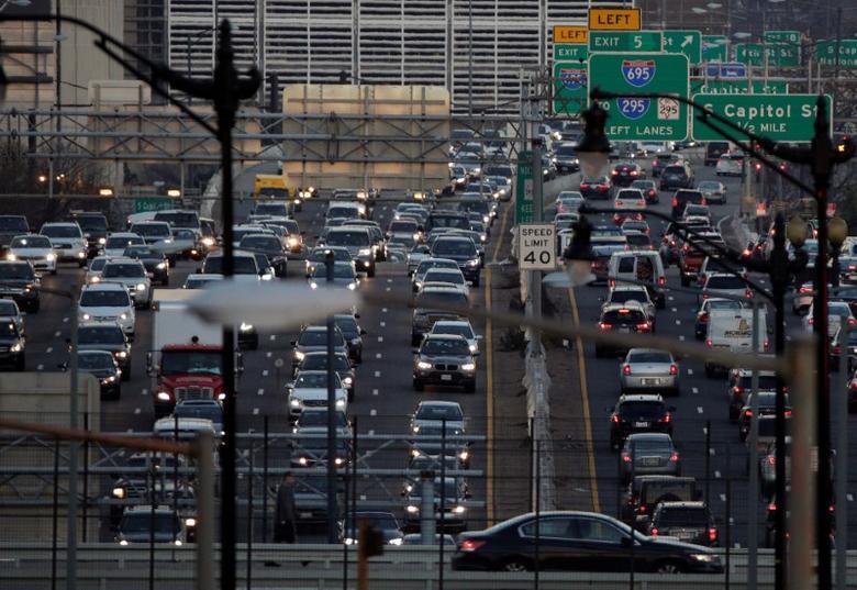 FILE PHOTO: Rush-hour traffic passes through Washington, U.S., December 20, 2016.   REUTERS/Joshua Roberts