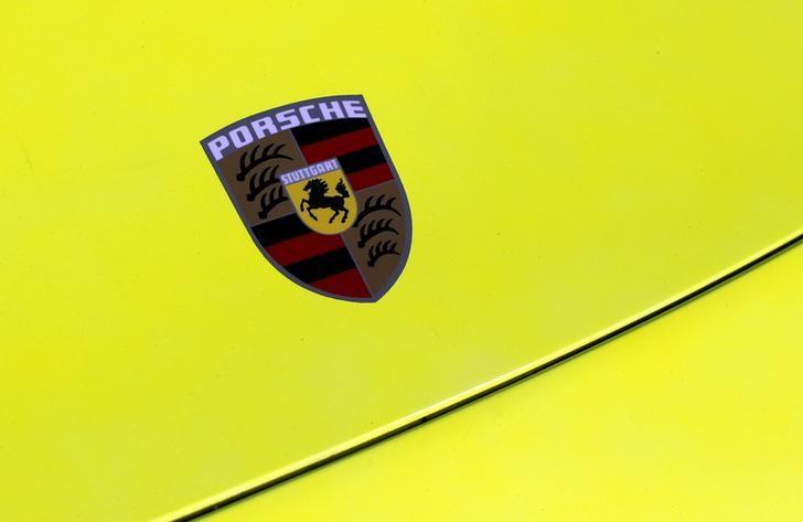 The Porsche logo is seen on the hood of a sports car during the Porsche Rennsport Reunion V at Laguna Seca Raceway near Salinas, California, U.S., September 26, 2015.    REUTERS/Michael Fiala/File Photo