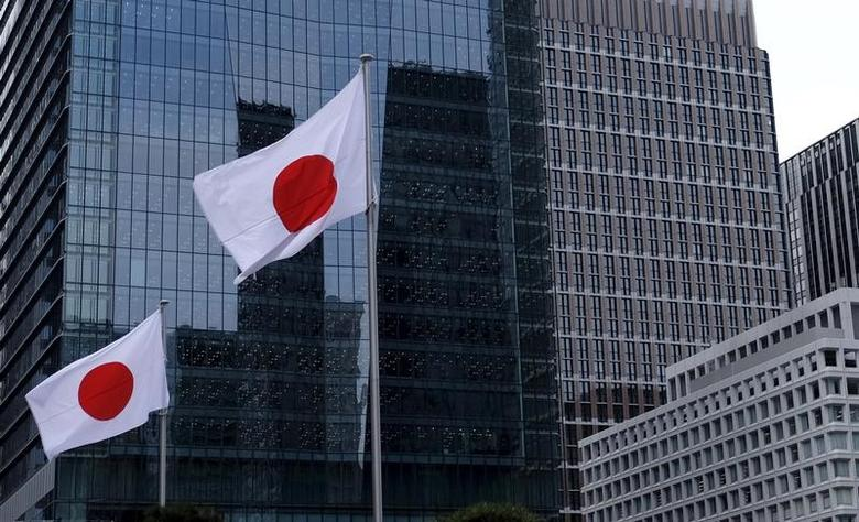 Japanese national flags flutter in front of buildings at Tokyo's business district in Japan, February 22, 2016. REUTERS/Toru Hanai/File Photo
